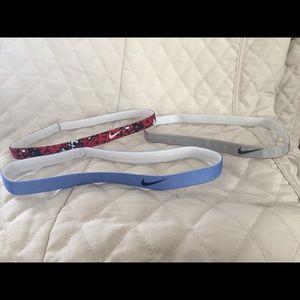 3 pairs of women's Nike headbands
